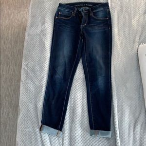 Dark article of society jeans